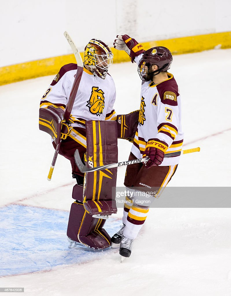 Kasimir Kaskisuo #33 of the Minnesota Duluth Bulldogs celebrates a victory with teammate Andy Welinski #7 against the Minnesota Golden Gophers during the NCAA Division I Men's Ice Hockey Northeast Regional Championship Semifinal at the Verizon Wireless Arena on March 27, 2015 in Manchester, New Hampshire. The Bulldogs won 4-1.