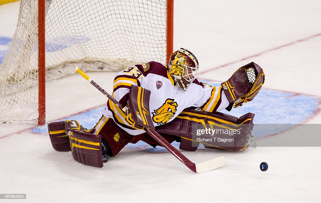 Kasimir Kaskisuo #33 of the Minnesota Duluth Bulldogs makes a leg save against the Minnesota Golden Gophers during the NCAA Division I Men's Ice Hockey Northeast Regional Championship Semifinal at the Verizon Wireless Arena on March 27, 2015 in Manchester, New Hampshire.