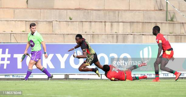 Kasito Adrian of Uganda challenged by Babacar Ba of Senegal during the 2019 Rugby Africa Mens 7s match between Senegal and Uganda at the Bosman...