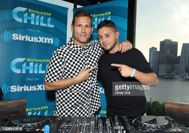 Kaskade poses for a photo with Alyx Ander before performing live on SiriusXM's Chill channel from the 1 Hotel on July 31 2018 in Brooklyn