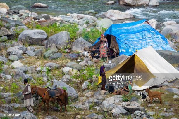 kasmiri people at beautiful mountain landscape of naranaq - shaifulzamri stock pictures, royalty-free photos & images