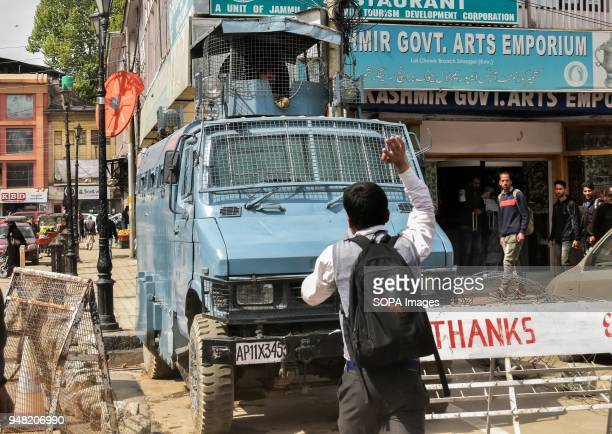 Kasmiri student shouts antiindia slogans in front of an Indian police vehicle during a protest rally against the rape and murder of an eightyearold...