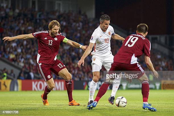 Kaspars Gorkss of Latvia Robin van Persie of Holland Vitalijs Jagodinskis of Latvia during the UEFA EURO 2016 qualifying match between Latvia and The...