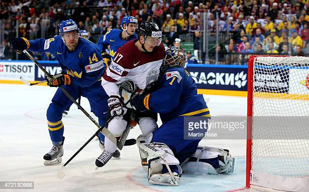 Kaspars Saulietis of Latvia is blocked by Jhonas Enroth goaltender of Sweden during the IIHF World Championship group A match between Latvia and...