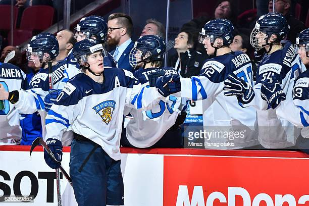 Kasper Bjorkqvist of Team Finland celebrates his third period goal with teammates on the bench during the IIHF World Junior Championship preliminary...