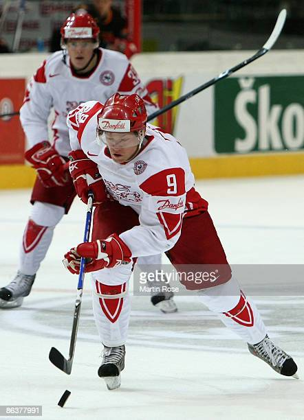 Kasper Degn of Denmark skates with the puck during the IIHF World Ice Hockey Championship relegation round match between Germany and Denmark at the...