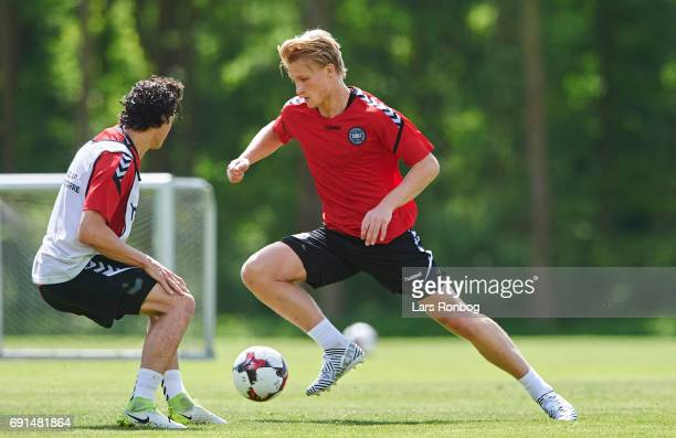 Kasper Dolberg and Thomas Delaney compete for the ball during to the Denmark training session at Brondby Stadion on June 2 2017 in Brondby Denmark