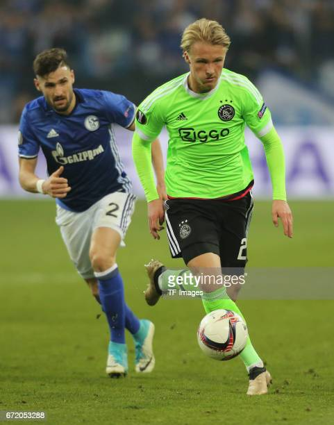 Kasper Dolberg of Ajax Amsterdam and Daniel Caligiuri of Schalke controls the ball during the UEFA Europa League quarter final second leg match...