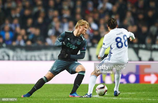 Kasper Dolberg of Ajax Amsterdam and Uros Matic of FC Copenhagen compete for the ball during the UEFA Europa League Round of 16 First Leg match...