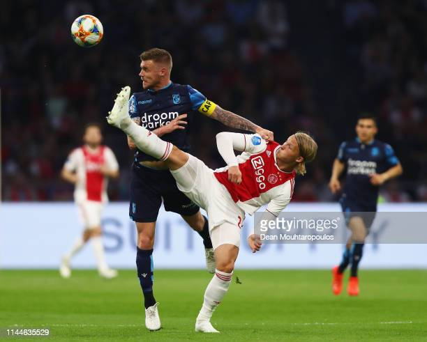 Kasper Dolberg of Ajax battles for the ball with Maikel van der Werff of Vitesse during the Eredivisie match between Ajax and Vitesse at Johan Cruyff...