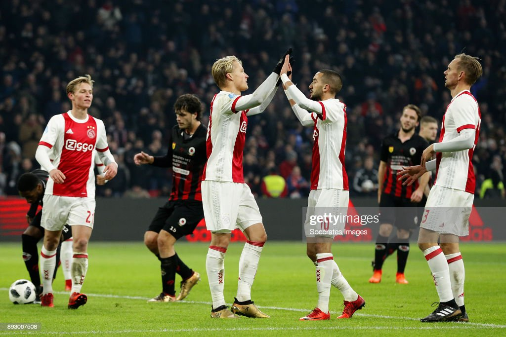 Kasper Dolberg of Ajax celebrates 2-1 with Hakim Ziyech of Ajax, Siem de Jong of Ajax during the Dutch Eredivisie match between Ajax v Excelsior at the Johan Cruijff Arena on December 14, 2017 in Amsterdam Netherlands