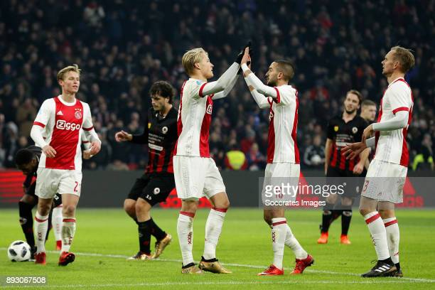 Kasper Dolberg of Ajax celebrates 21 with Hakim Ziyech of Ajax Siem de Jong of Ajax during the Dutch Eredivisie match between Ajax v Excelsior at the...