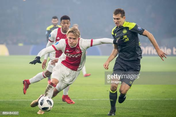 Kasper Dolberg of Ajax Daniel Schwaab of PSV during the Dutch Eredivisie match between Ajax Amsterdam and PSV Eindhoven at the Amsterdam Arena on...
