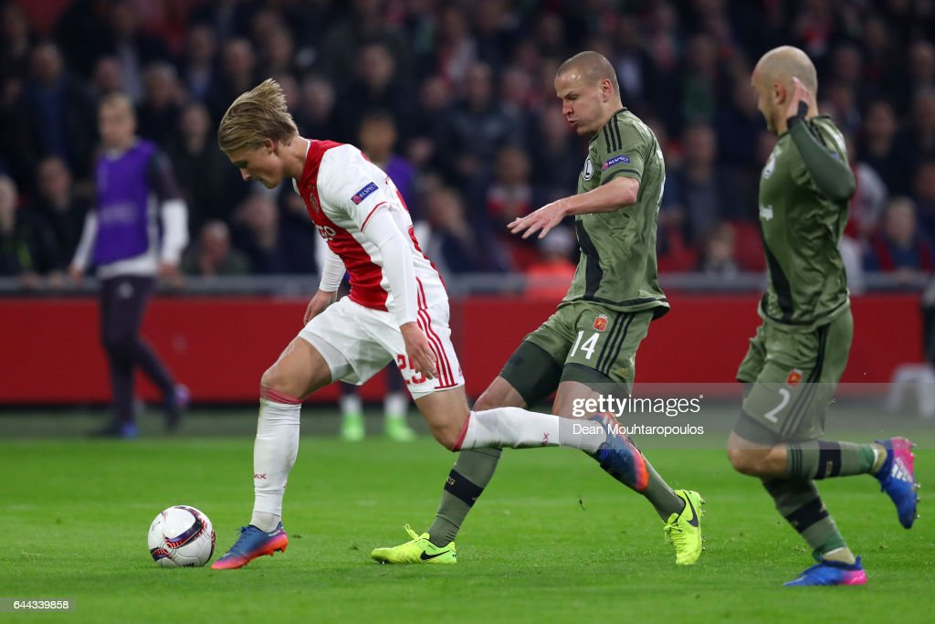 Kasper Dolberg of Ajax evades Adam Hlousek (14) and Michal Pazdan of Legia Warszawa (2) during the UEFA Europa League Round of 32 second leg match between Ajax Amsterdam and Legia Warszawa at Amsterdam Arena on February 23, 2017 in Amsterdam, Netherlands.