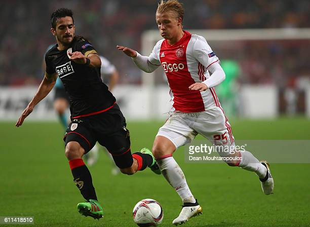Kasper Dolberg of Ajax is closed down by Konstantinos Laifis of Standard Liege during the UEFA Europa League group G match between AFC Ajax and R...