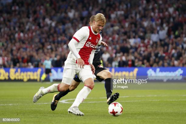 Kasper Dolberg of Ajax, Maxime Le Marchand of OCG Nice during the UEFA Champions League third round qualifying first leg match between Ajax Amsterdam...