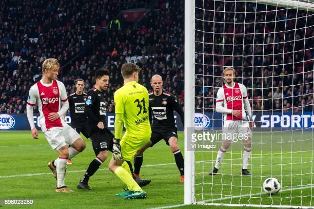 Kasper Dolberg of Ajax scores during the Dutch Eredivisie match between Ajax Amsterdam and Willem II Tilburg at the Amsterdam Arena on December 24...