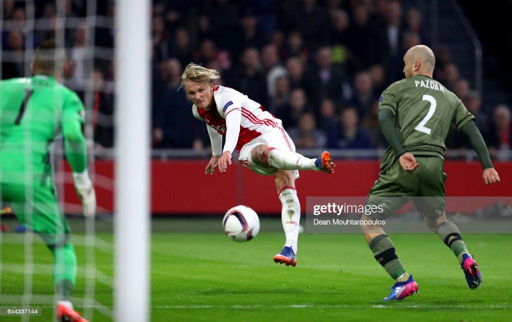 Kasper Dolberg of Ajax (C) shoots as Arkadiusz Malarz (1) and Michal Pazdan of Legia Warszawa (2) look on during the UEFA Europa League Round of 32 second leg match between Ajax Amsterdam and Legia Warszawa at Amsterdam Arena on February 23, 2017 in Amsterdam, Netherlands.