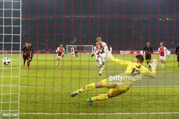 Kasper Dolberg of Ajax Theo Zwarthoed of Excelsior during the Dutch Eredivisie match between Ajax Amsterdam and sbv Excelsior at the Amsterdam Arena...