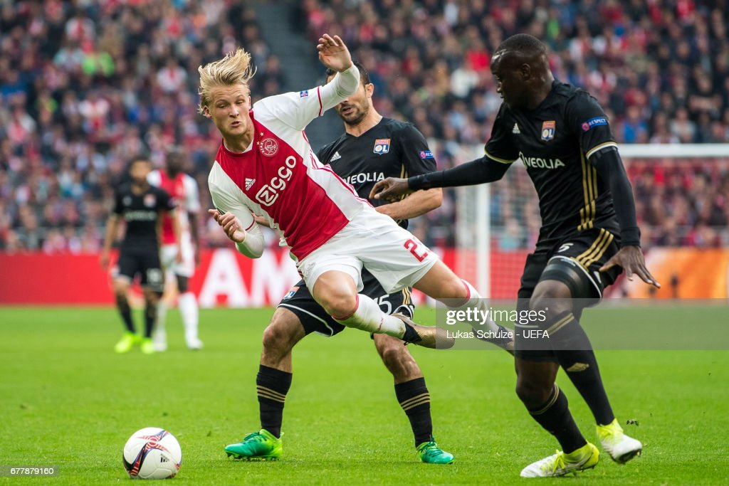 Kasper Dolberg (L) of Amsterdam is attacked by Jeremy Morel (M) and Nicolas Nkoulou (R) of Lyon during the Uefa Europa League, semi final first leg match, between Ajax Amsterdam and Olympique Lyonnais at Amsterdam Arena on May 3, 2017 in Amsterdam, Netherlands.
