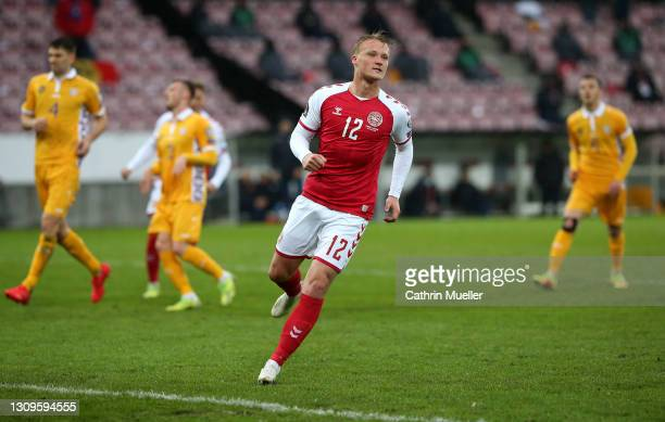 Kasper Dolberg of Denmark celebrates after scoring their side's first goal from the penalty spot during the FIFA World Cup 2022 Qatar qualifying...