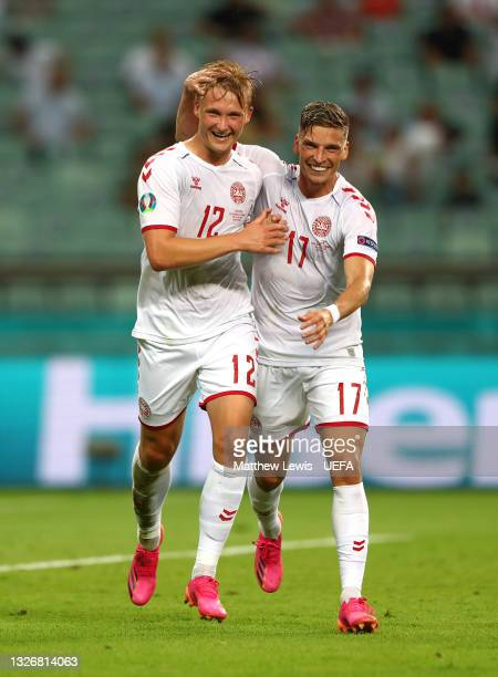 Kasper Dolberg of Denmark celebrates with Jens Stryger Larsen after scoring their side's second goal during the UEFA Euro 2020 Championship...