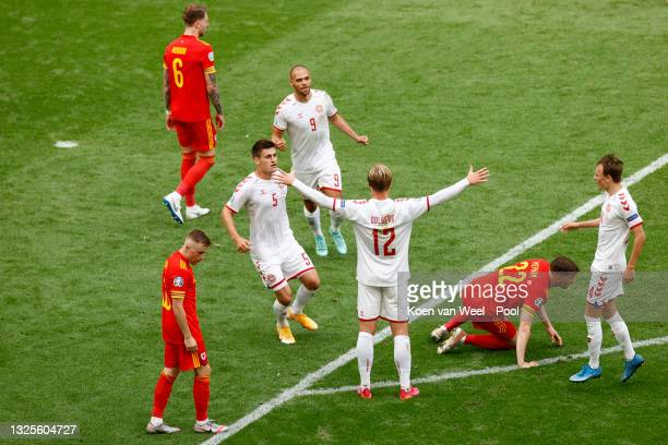 Kasper Dolberg of Denmark celebrates with Joakim Maehle, Martin Braithwaite and Mikkel Damsgaard after scoring their side's first goal during the...