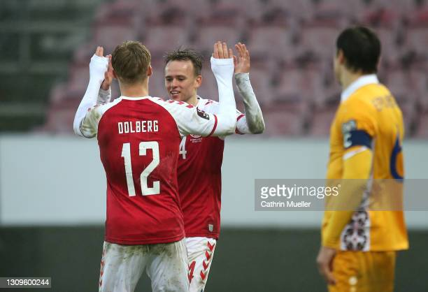 Kasper Dolberg of Denmark celebrates with team mate Mikkel Damsgaard of Denmark after scoring their side's sixth goal during the FIFA World Cup 2022...