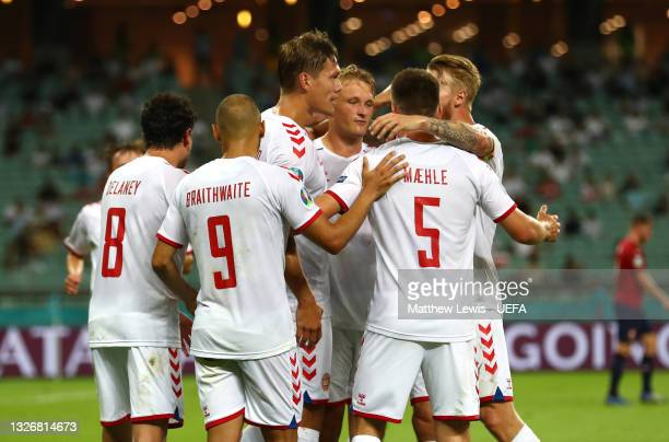 Kasper Dolberg of Denmark celebrates with team mates after scoring their side's second goal during the UEFA Euro 2020 Championship Quarter-final...