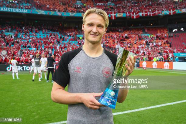 """Kasper Dolberg of Denmark poses for a photograph with their Heineken """"Star of the Match"""" award after the UEFA Euro 2020 Championship Round of 16..."""