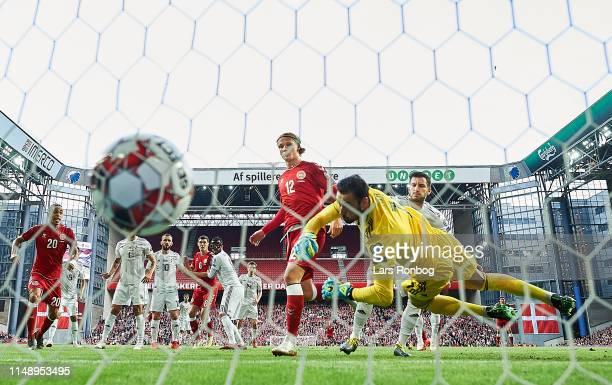 Kasper Dolberg of Denmark scores the 10 goal against Goalkeeper Giorgi Loria of Georgia during the UEFA Euro 2020 Qualifier match between Denmark and...