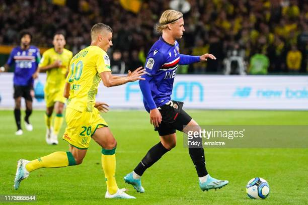 Kasper DOLBERG of Nice and Andrei GIROTTO of Nantes during the Ligue 1 match between FC Nantes and OGC Nice at Stade de la Beaujoire on October 5,...