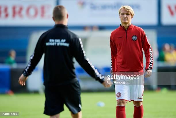 Kasper Dolberg speaks to Jon Dahl Tomasson assistant coach of Denmark during the Denmark training session at Helsingor Stadion on August 29 2017 in...