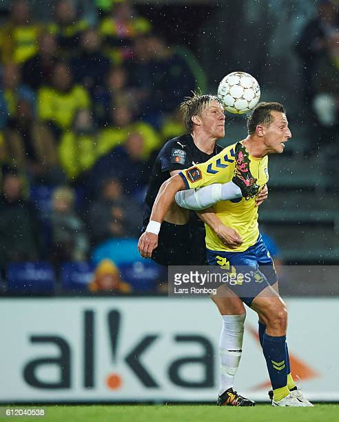 Kasper Enghardt of Randers FC and Kamil Wilczek of Brondby IF compete for the ball during the Danish Alka Superliga match between Brondby IF and...