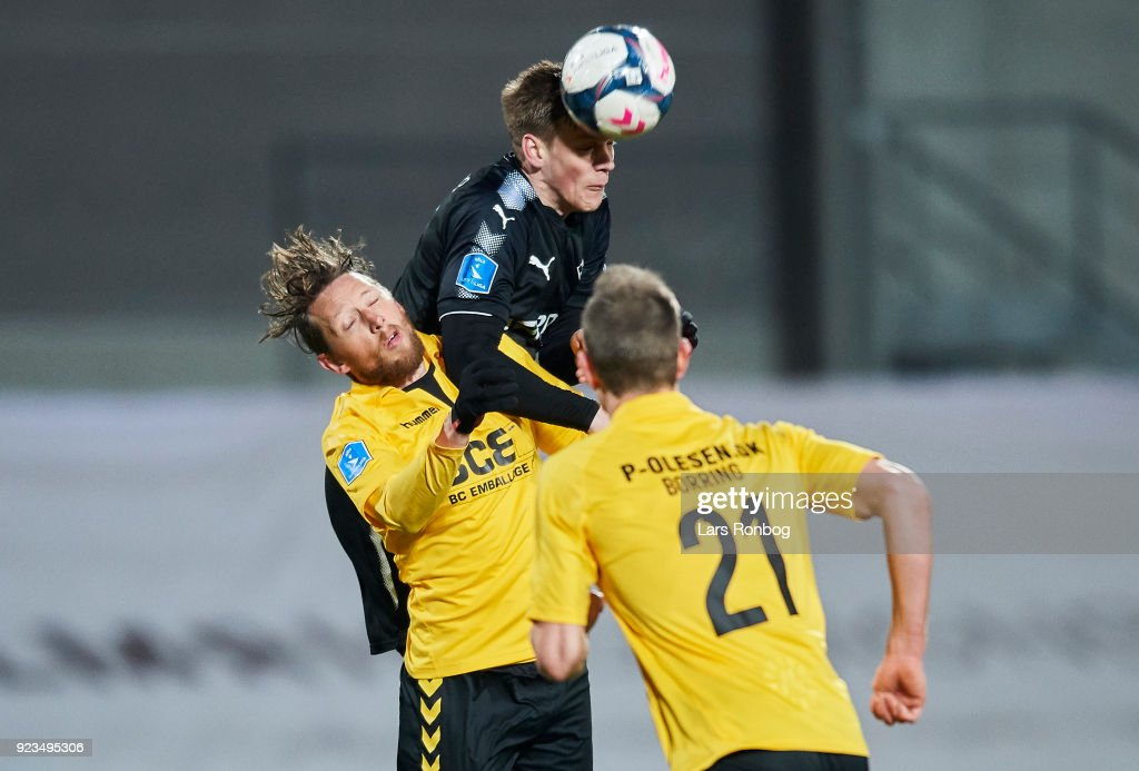 Kasper Enghardt of Randers FC and Lasse Kryger of AC Horsens compete for the ball during the Danish Alka Superliga match between Randers FC and Hobro IK at BioNutria Park on February 18, 2018 in Randers, Denmark.