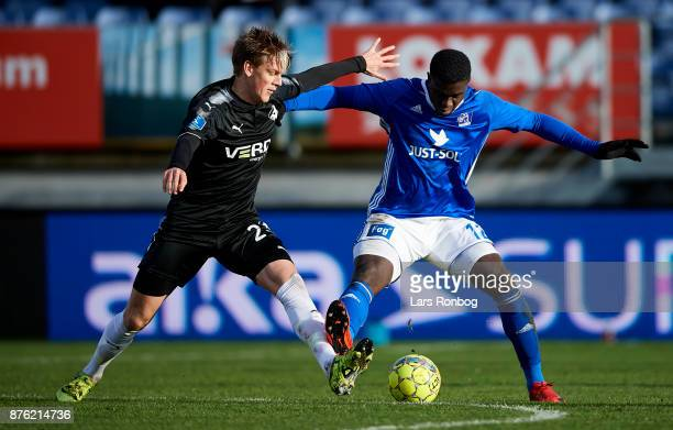 Kasper Enghardt of Randers FC and Mayron George of Lyngby BK compete for the ball during the Danish Alka Superliga match between Lyngby BK and...