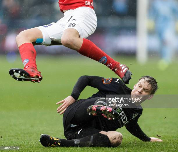 Kasper Enghardt of Randers FC and Robert Skov compete for the ball during the Danish Alka Superliga match between Silkeborg IF and Randers FC at...