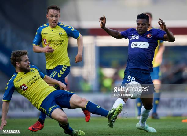 Kasper Fisker of Brondby IF and Frank Onyeka of FC Midtjylland compete for the ball during the Danish Alka Superliga match between Brondby IF and FC...