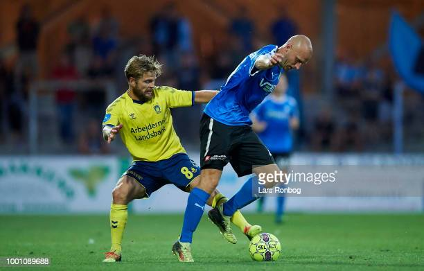 Kasper Fisker of Brondby IF and Johnny Thomsen of Randers FC compete for the ball during the Danish Superliga match between Randers FC and Brondby IF...