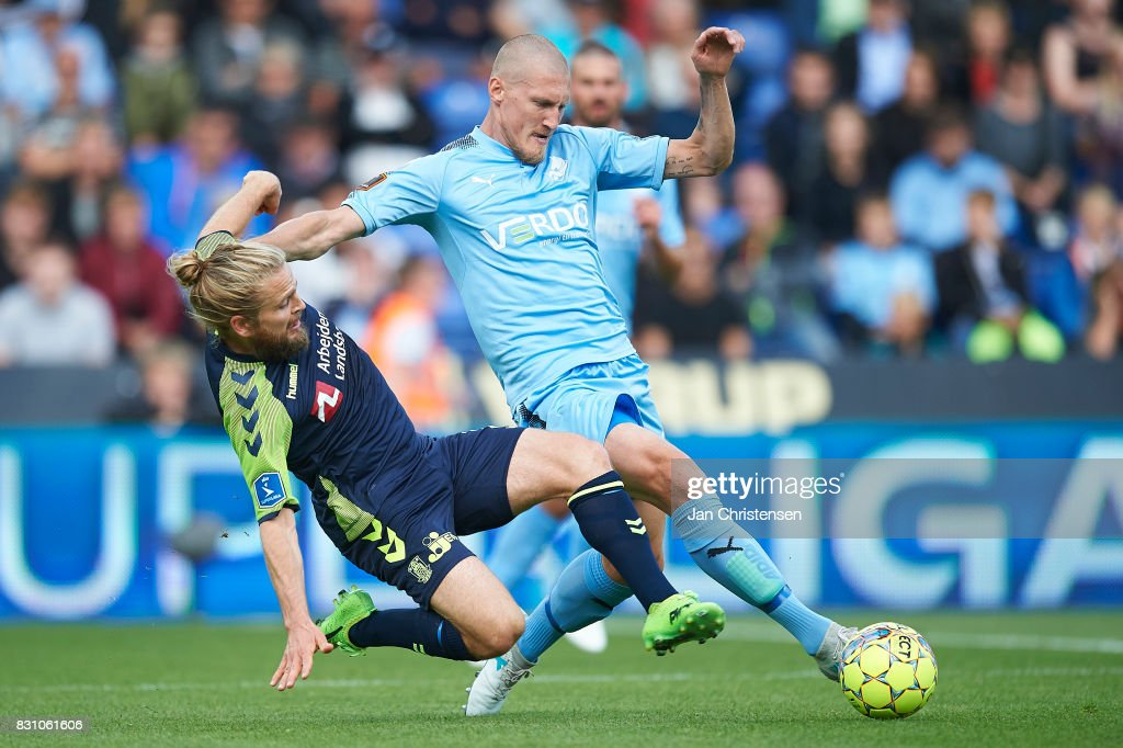 Kasper Fisker of Brondby IF and Joni Kauko of Randers FC compete for the ball during the Danish Alka Superliga match between Randers FC and Brondby IF at BioNutria Park Randers on August 13, 2017 in Randers, Denmark.