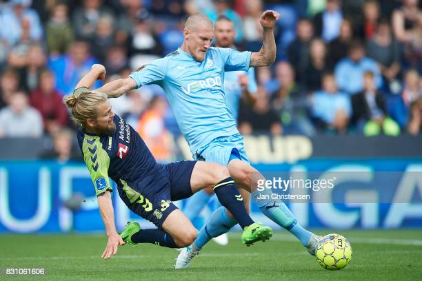 Kasper Fisker of Brondby IF and Joni Kauko of Randers FC compete for the ball during the Danish Alka Superliga match between Randers FC and Brondby...