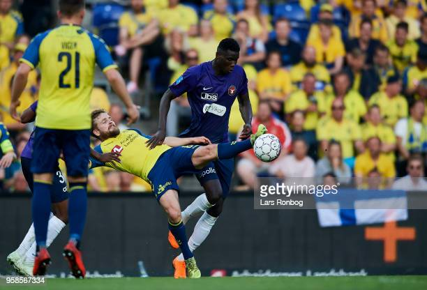 Kasper Fisker of Brondby IF and Paul Onuachu of FC Midtjylland compete for the ball during the Danish Alka Superliga match between Brondby IF and FC...