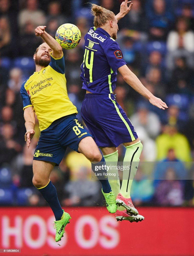 Kasper Fisker of Brondby IF and Simon Kroon of FC Midtjylland compete for the ball during the Danish Alka Superliga match between Brondby IF and FC Midtjylland at Brondby Stadion on July 16, 2017 in Brondby, Denmark.