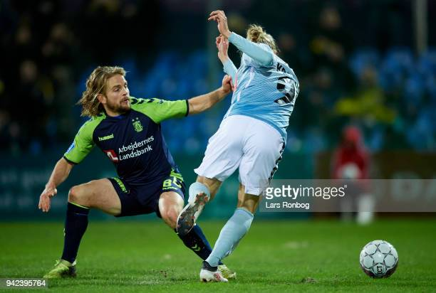 Kasper Fisker of Brondby IF and Simon Kroon of Sonderjyske compete for the ball during the Danish DBU Pokalen Cup quarterfinal match between...