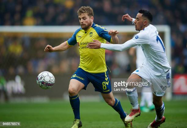 Kasper Fisker of Brondby IF and Zeca of FC Copenhagen compete for the ball during the Danish Alka Superliga match between Brondby IF and FC...