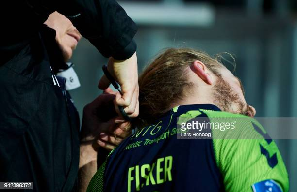Kasper Fisker of Brondby IF has his hair cut before extra time during the Danish DBU Pokalen Cup quarterfinal match between Sonderjyske and Brondby...