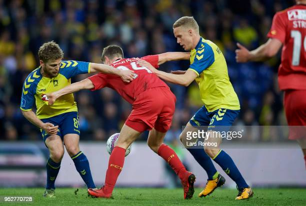 Kasper Fisker of Brondby IF Mathias Rasmussen of FC Nordsjælland and Hjortur Hermannsson of Brondby IF compete for the ball during the Danish Alka...
