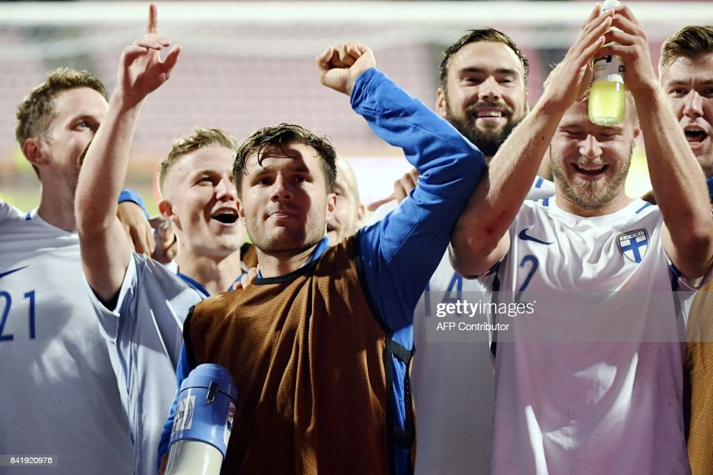 Kasper Hamalainen (L), Alexander Ring, Perparim Hetemaj, Tim Sparv and Paulus Arajuuri of Finland celebrate the team's 1-0 victory over Iceland after the FIFA World Cup 2018 qualification football match between Finland and Iceland in Tampere on September 2, 2017. / AFP PHOTO / Lehtikuva / Jussi Nukari