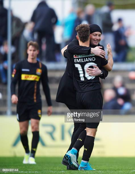 Kasper Hjulmand head coach of FC Nordsjalland and Emiliano Marcondes of FC Nordsjalland celebrate after the Danish Alka Superliga match between...