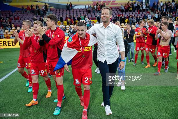 Kasper Hjulmand head coach of FC Nordsjalland congratulates Karlo Bartolec of FC Nordsjalland after FC Nordsjaelland won the bronzemedal in the...